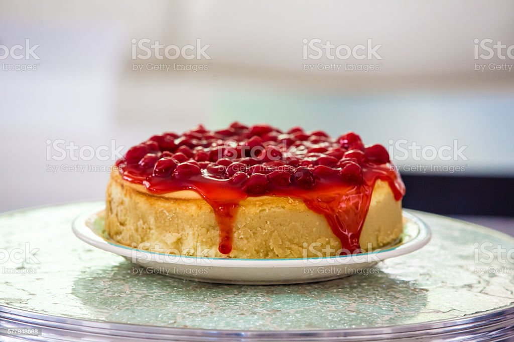 Delicious homemade cherry cheesecake on a glass table stock photo