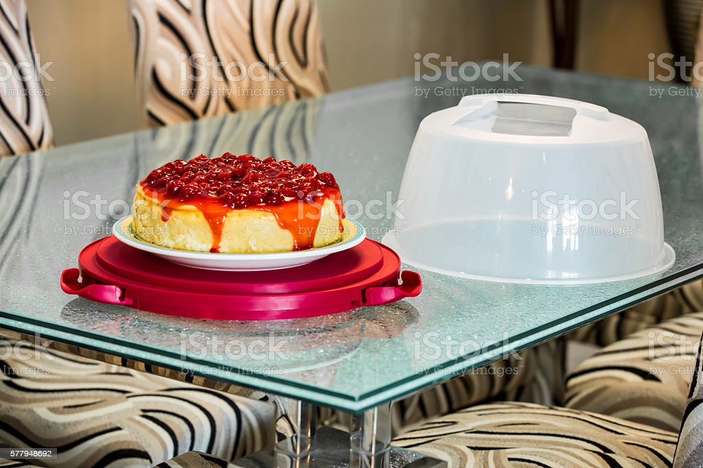 Delicious homemade cherry cheesecake with travel carrier stock photo