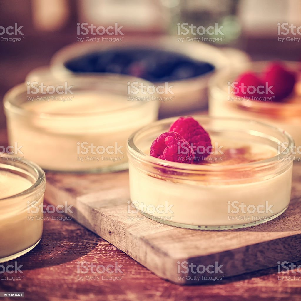 Delicious Homemade Creme Brulee with Berries stock photo