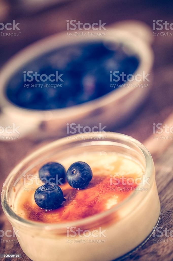 Delicious Homemade Creme Brulee with Blueberries stock photo