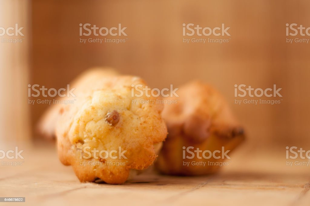 delicious Homemade muffins with raisins in warm color background stock photo