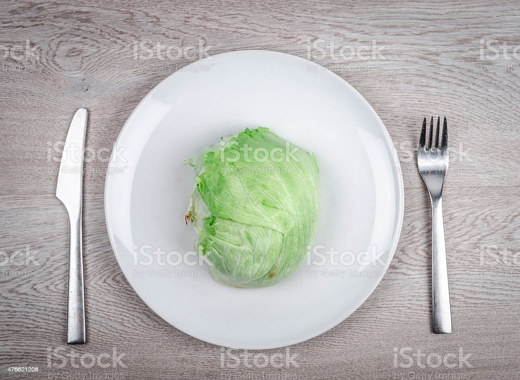Delicious iceberg lettuce on a plate stock photo