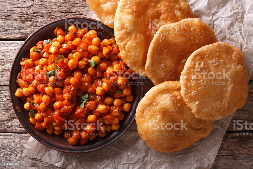 Delicious Indian Chana masala and puri close-up. Horizontal stock photo