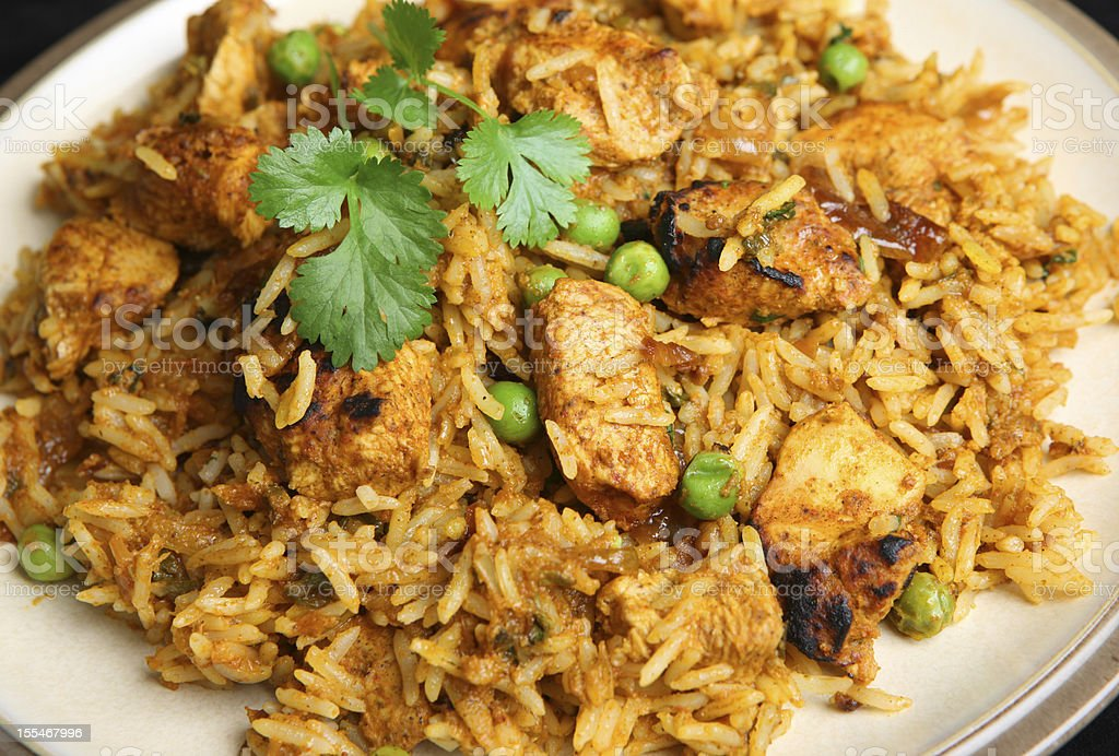 Delicious Indian Chicken Tikka Biriyani on white plate stock photo