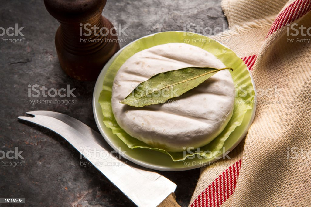 delicious italian cheese tomino with bacon grilled stock photo