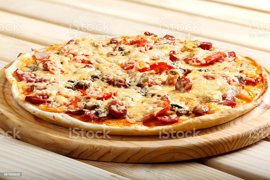 Delicious italian pizzas served on wooden table stock photo