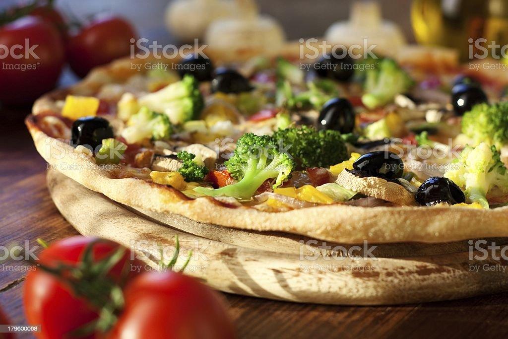 A delicious Italian supreme pizza dinner stock photo