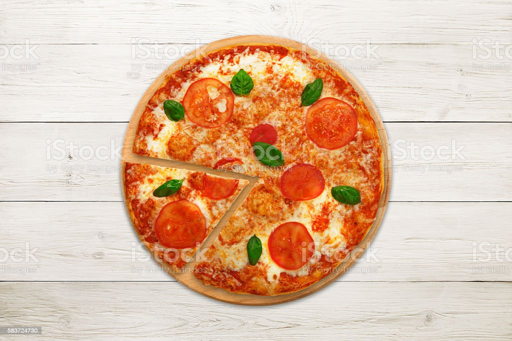 Delicious italian vegetarian pizza Margherita top view at wood stock photo