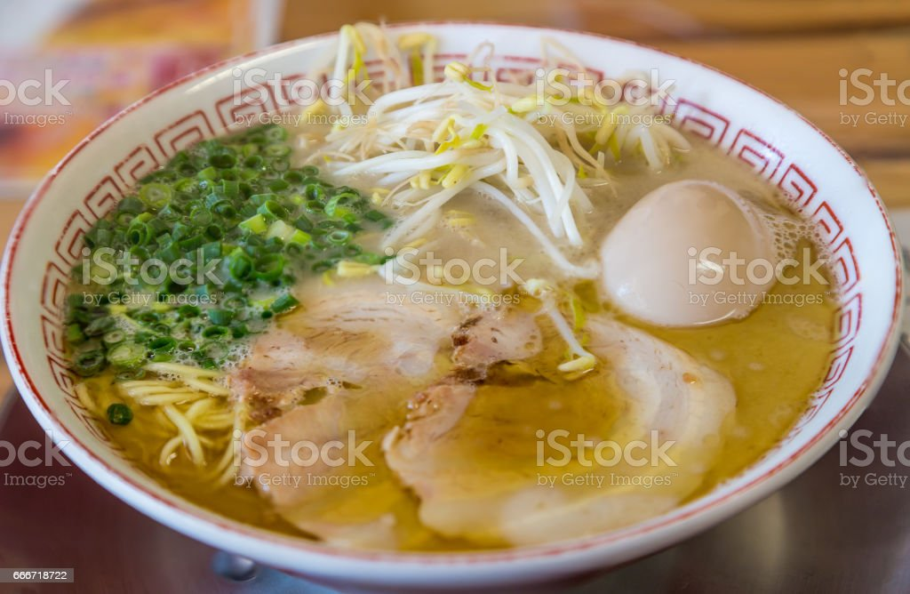 Delicious Japanese chashu ramen with boiled egg and vegetable stock photo