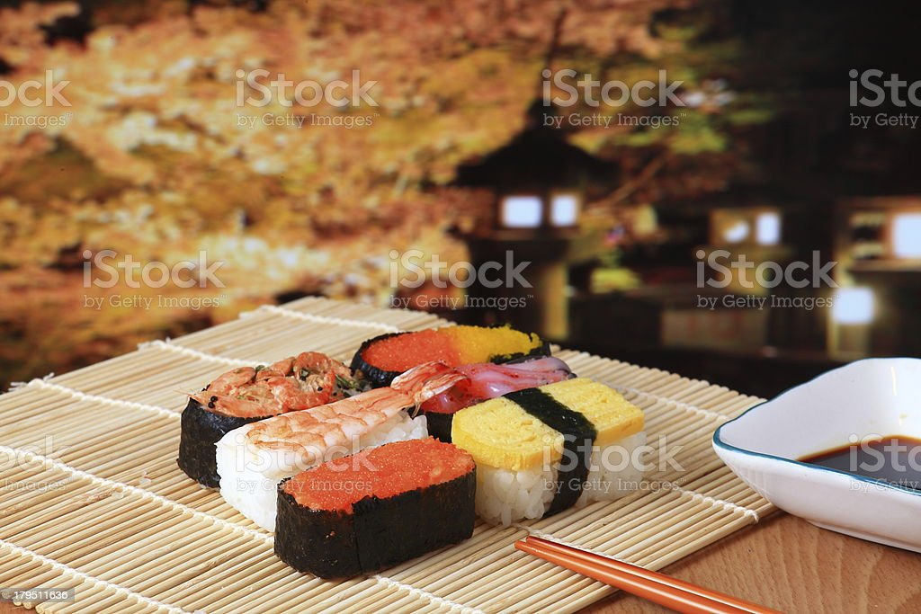delicious Japanese sushi mix with beautiful japan night scenes royalty-free stock photo