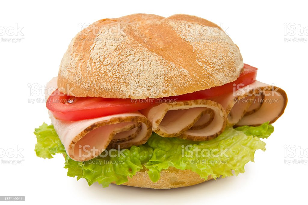 Delicious kaiser roll with turkey/chicken breast, lettuce and tomatoes stock photo