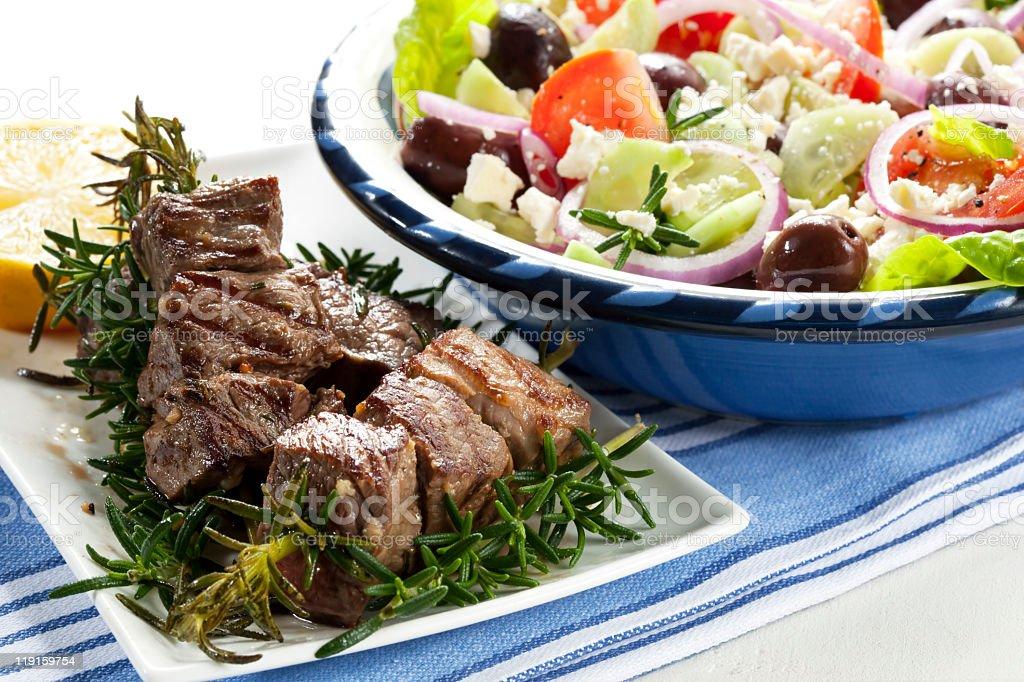 A delicious lamb kebab with Greek salad  royalty-free stock photo