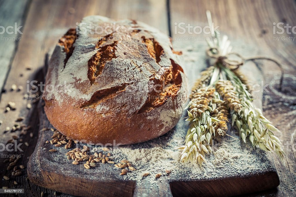 Delicious loaf of bread with wheat stock photo
