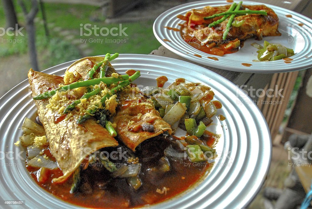 Delicious looking plated Mexican Enchiladas with Asparagus stock photo