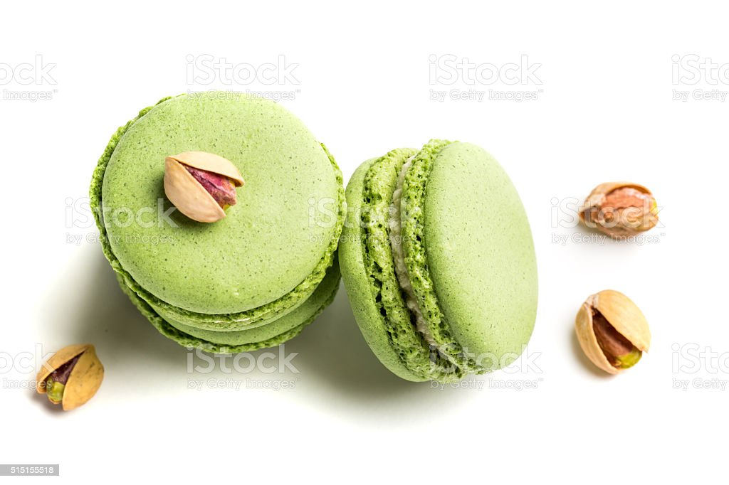Delicious macaroons with pistachio on white background stock photo