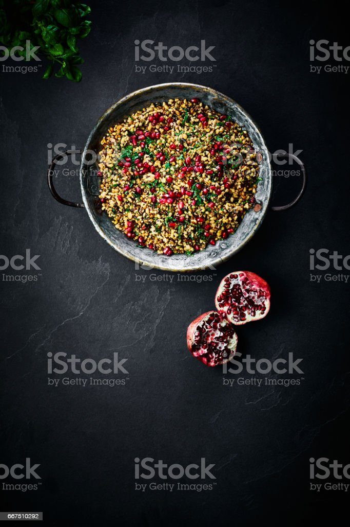Delicious Moroccan salad in a cooking pan with pomegranate stock photo