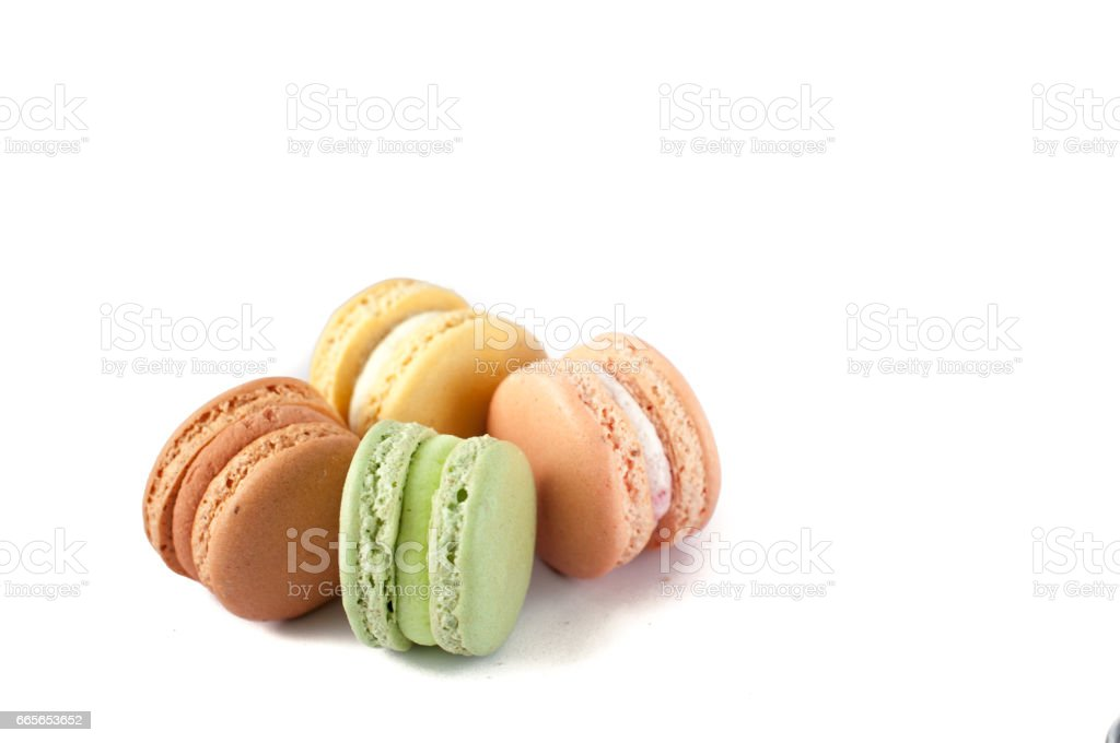 Delicious multicolored cake macaron or macaroon on a white background. sweet and colorful dessert. stock photo