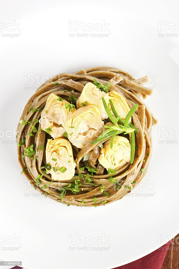 Delicious organic pasta with artichoke hearts. royalty-free stock photo