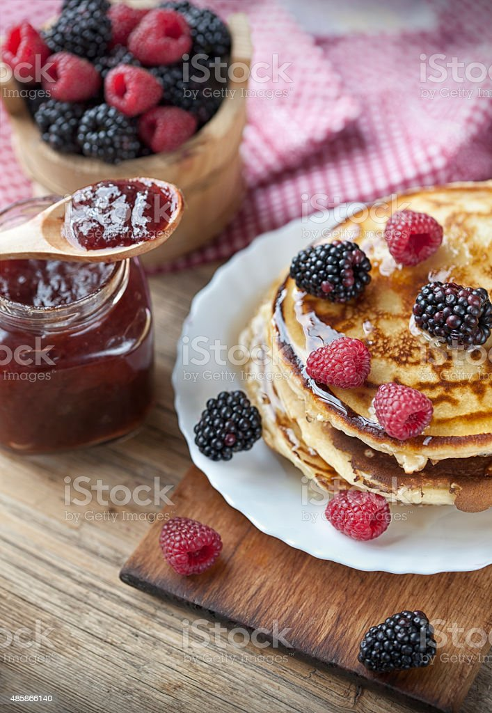 Delicious pancakes with berries stock photo