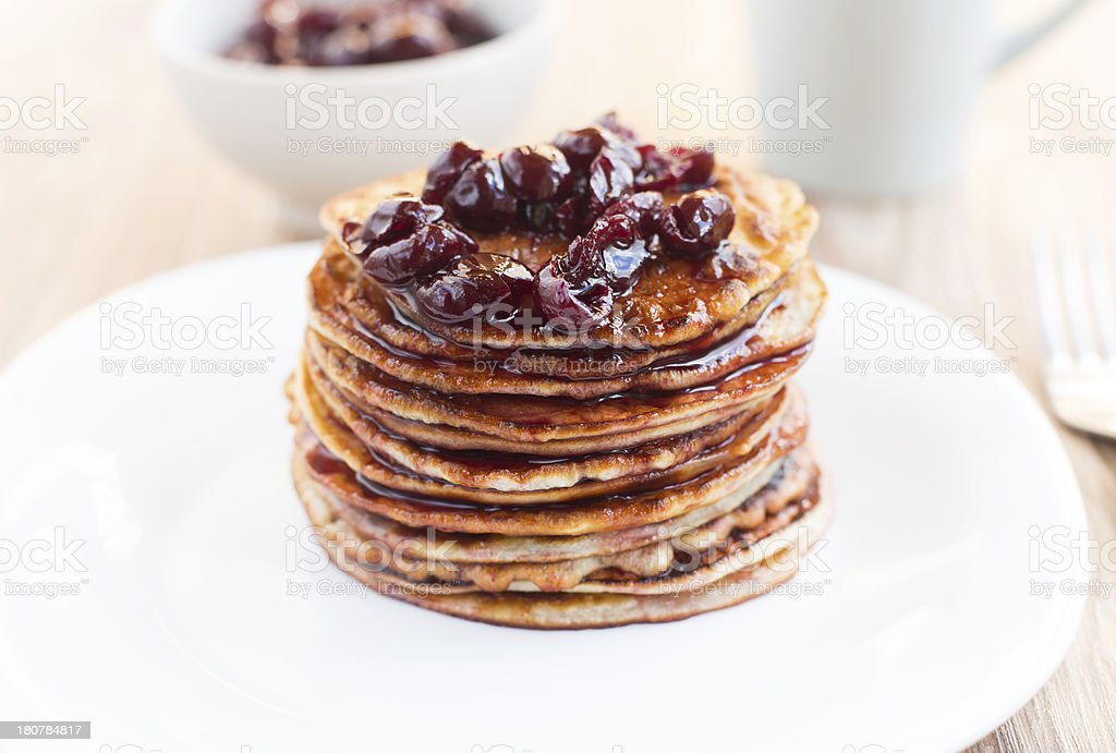 Delicious pancakes with cherry jam royalty-free stock photo