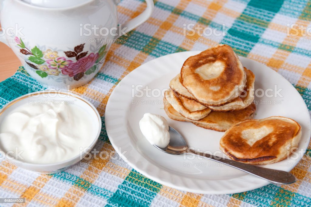 Delicious pancakes with sour cream for breakfast stock photo