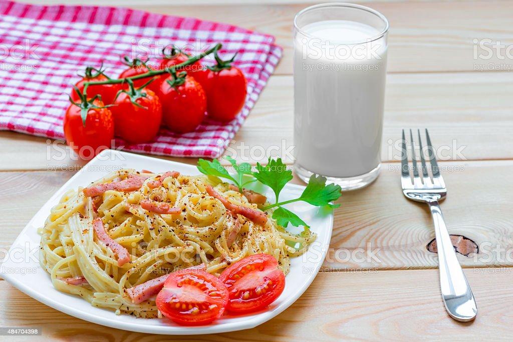 delicious pasta carbonara on wooden table stock photo