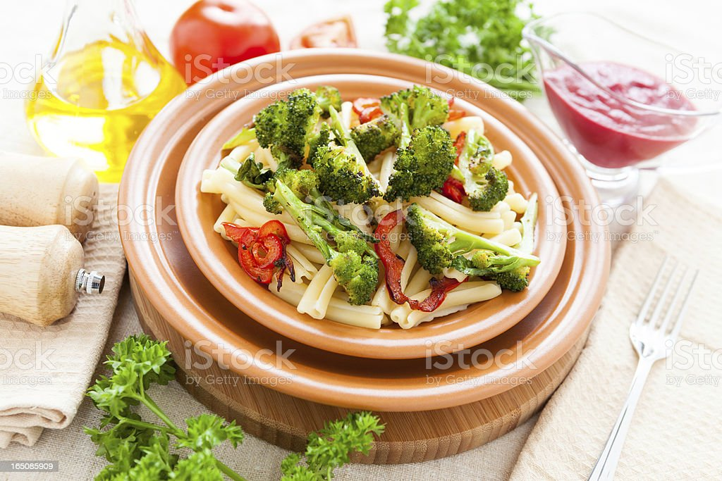 Delicious Pasta with roasted vegetables broccoli and pepper royalty-free stock photo