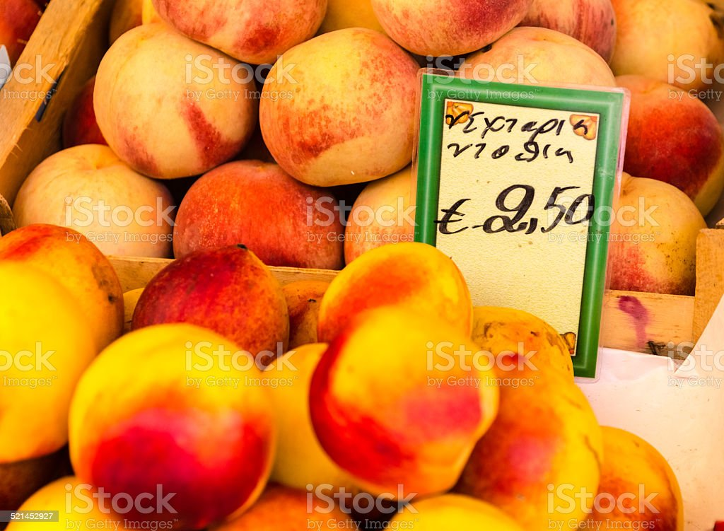 Delicious peaches on display at a farmer's market. stock photo
