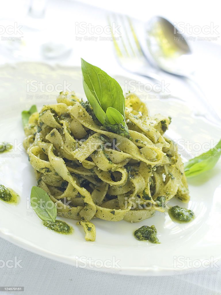 Delicious pesto pasta served on a white plate stock photo
