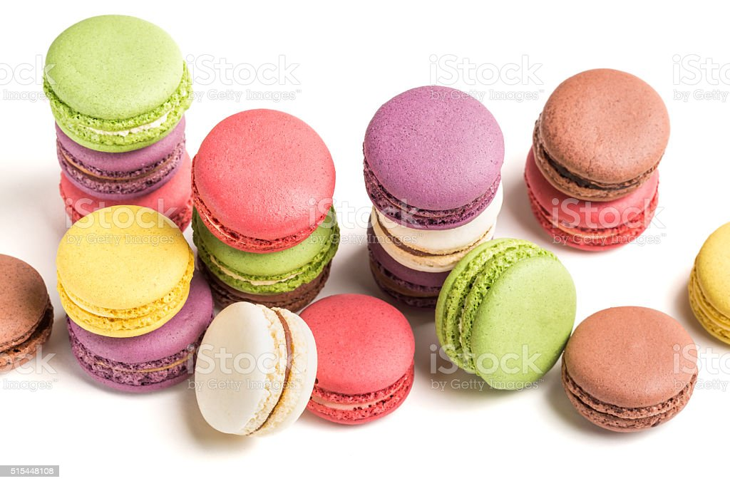Delicious pile of macaroons on white background stock photo