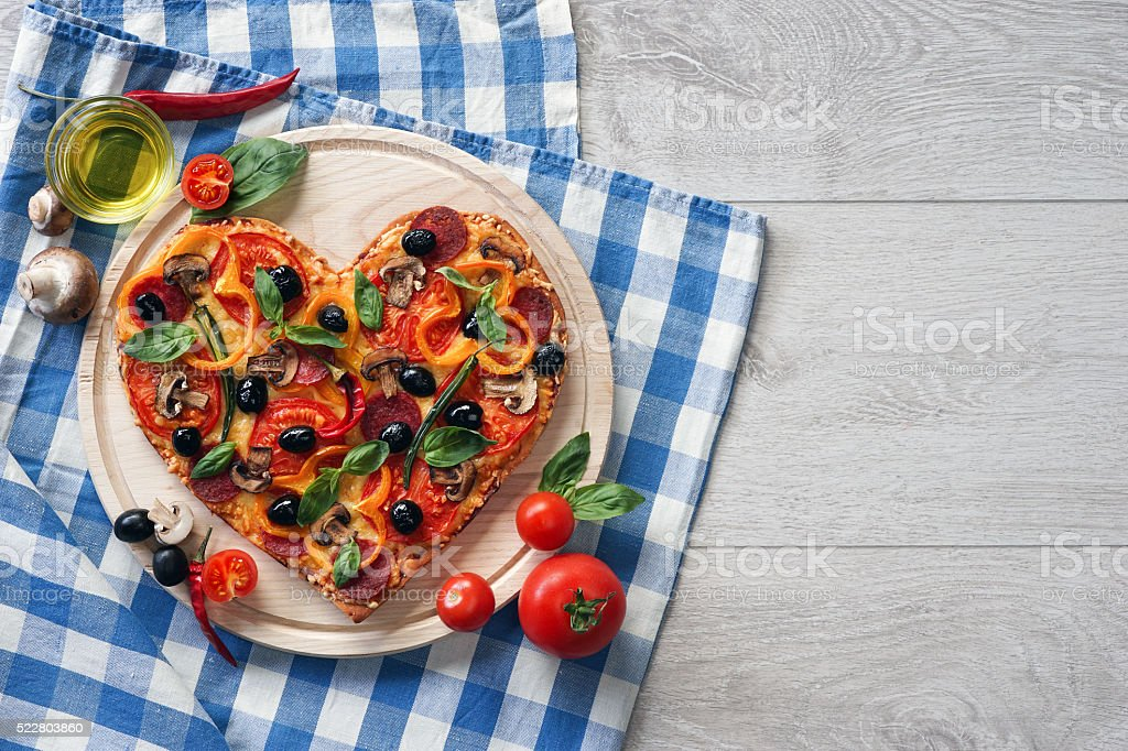 Delicious pizza served on white wooden table. stock photo