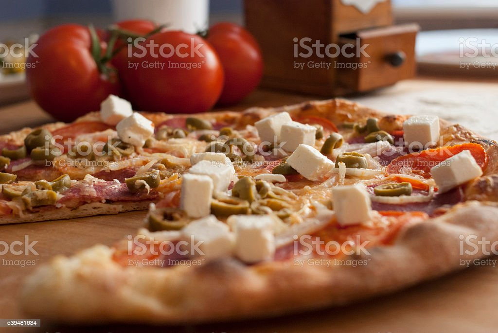 Delicious pizza served on wooden board stock photo