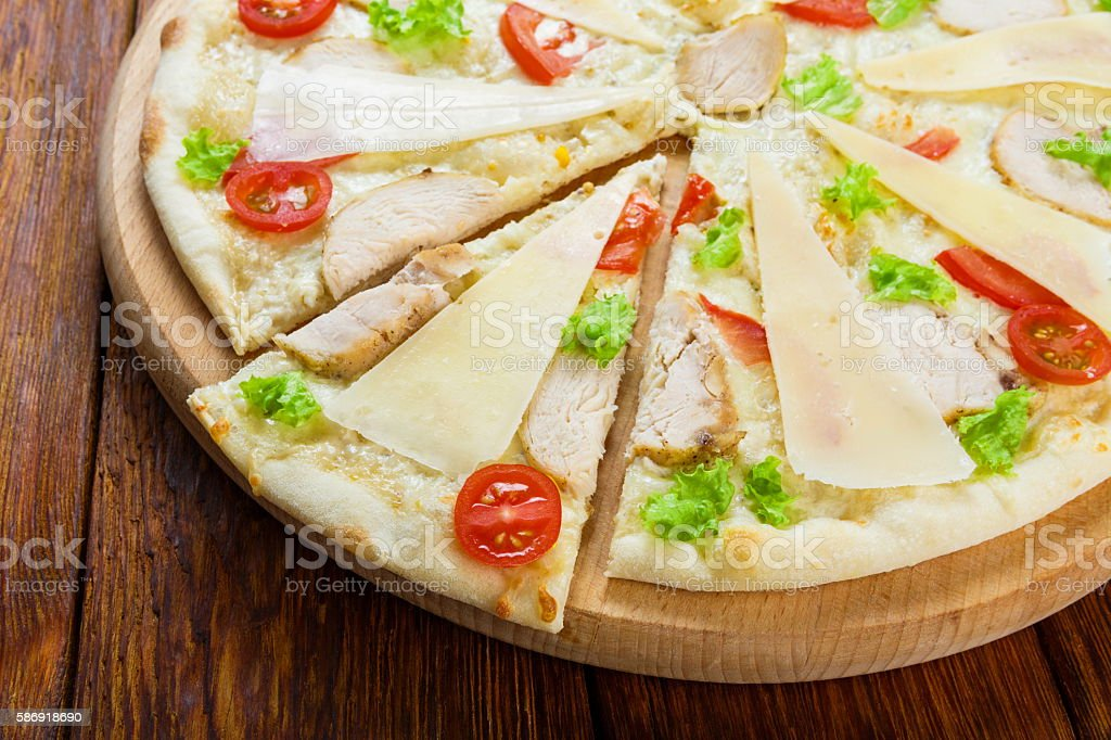 Delicious pizza with chicken - Caesar style stock photo