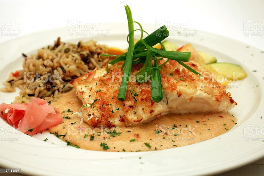 A delicious platter of Macadamia Crusted Halibut royalty-free stock photo