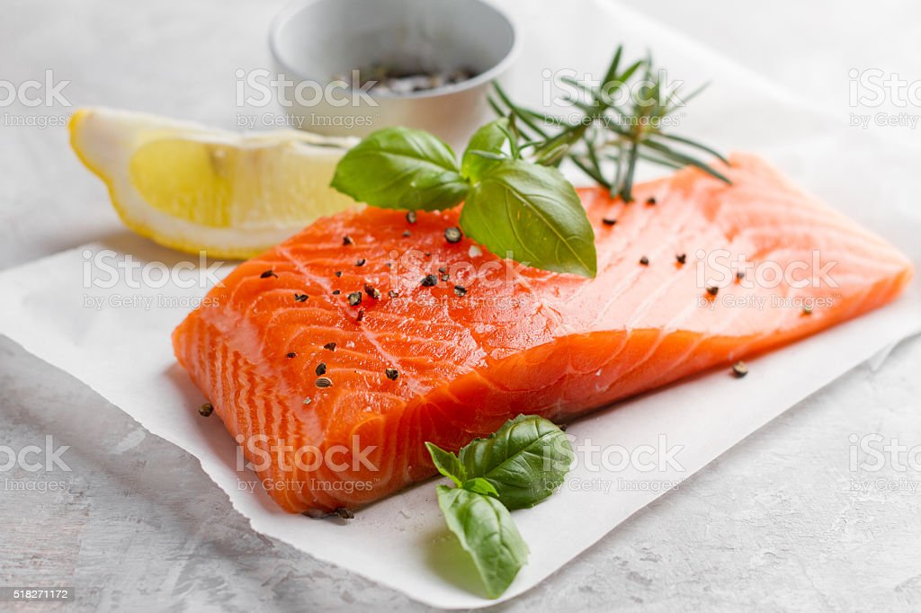 Delicious portion of fresh salmon fillet stock photo