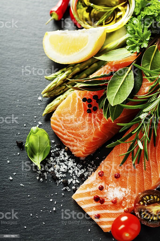 Delicious  portion of  fresh salmon fillet  with aromatic herbs, royalty-free stock photo