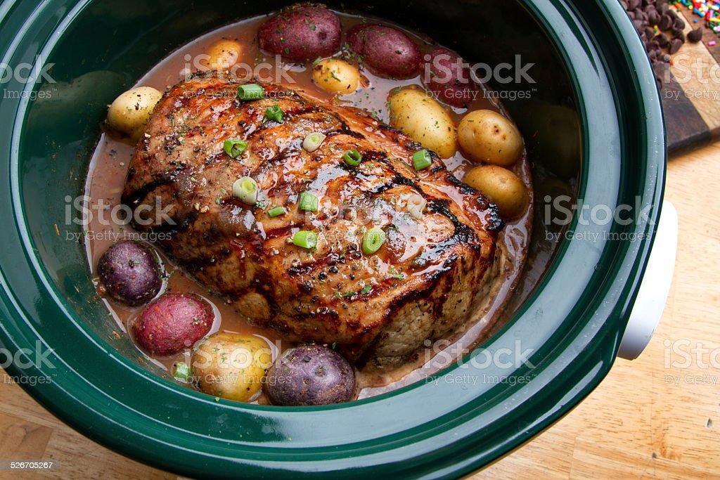 Delicious Pot Roast Dinner in a Crock Pot stock photo