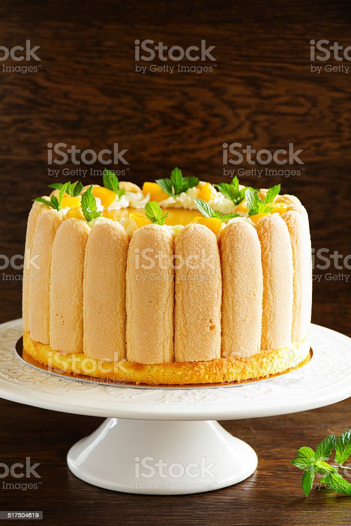 Delicious pound cake 'Charlotte' with mango and peaches. stock photo