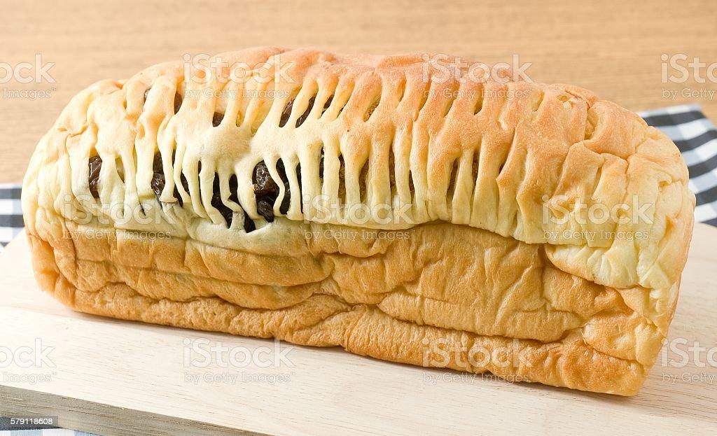 Delicious Raisin Bread on A Wooden Cutting Board stock photo