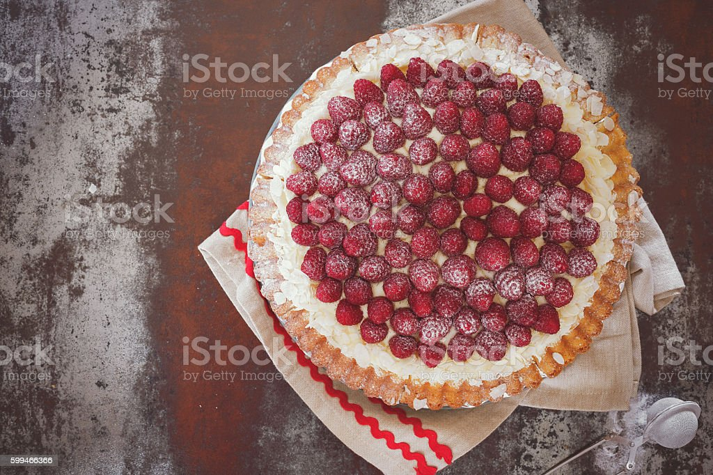 Delicious raspberry tart with fresh raspberries stock photo