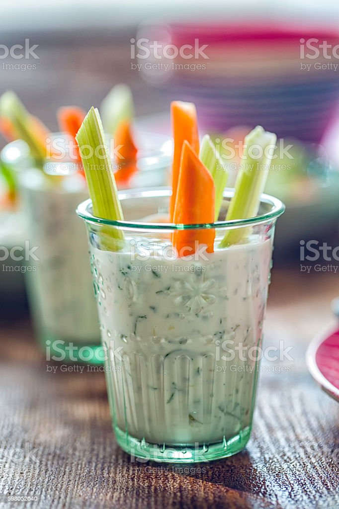 Delicious Raw Carrots and Celery Sticks with a Dip stock photo