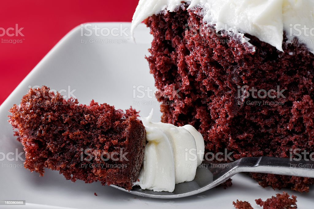 Delicious red velvet cake with white frosting on a plate royalty-free stock photo