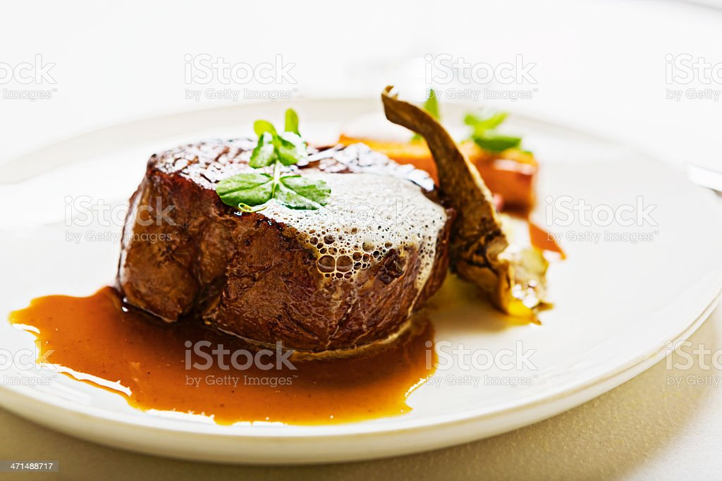 Delicious restaurant meal of grilled fillet steak with exotic garnishes stock photo