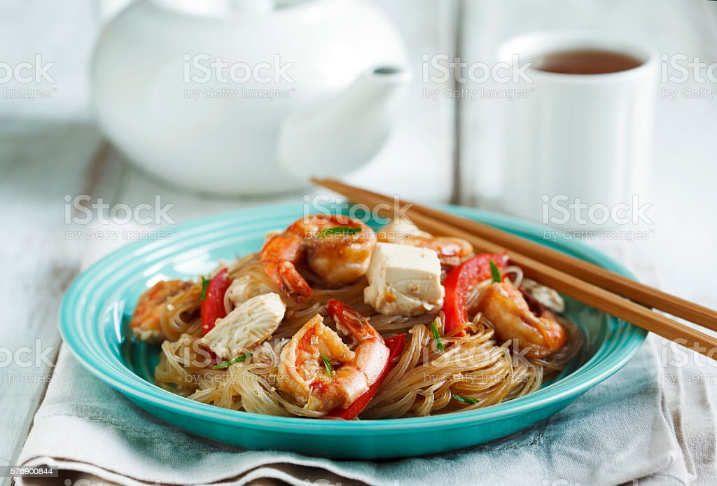 Delicious rice noodles with garlic shrimp and tofu stock photo