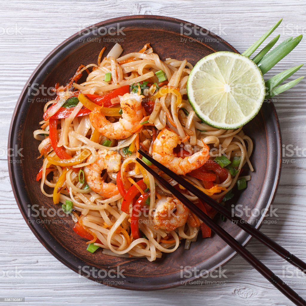 Delicious rice noodles with shrimp and vegetables  top view stock photo