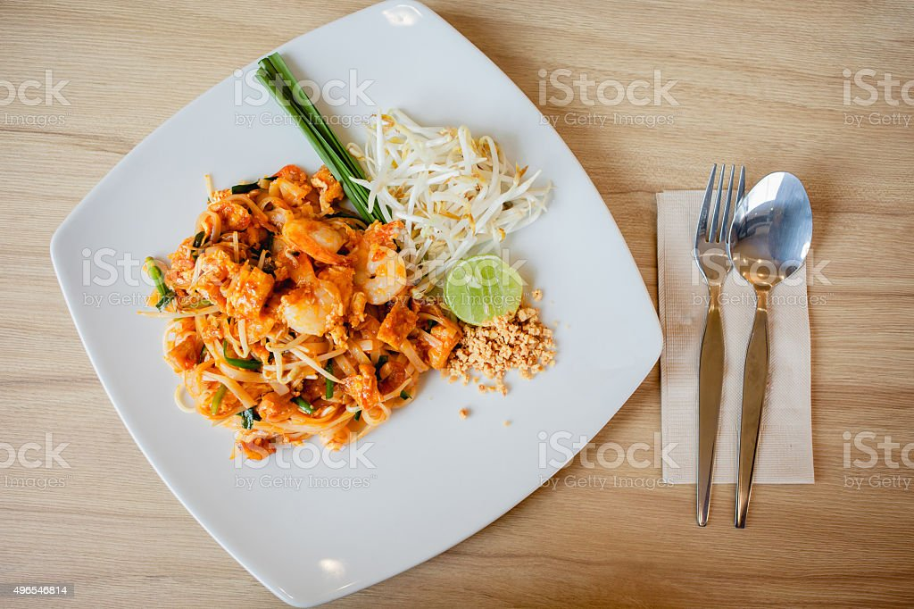 Delicious rice noodles with shrimp close-up on a plate. horizontal stock photo
