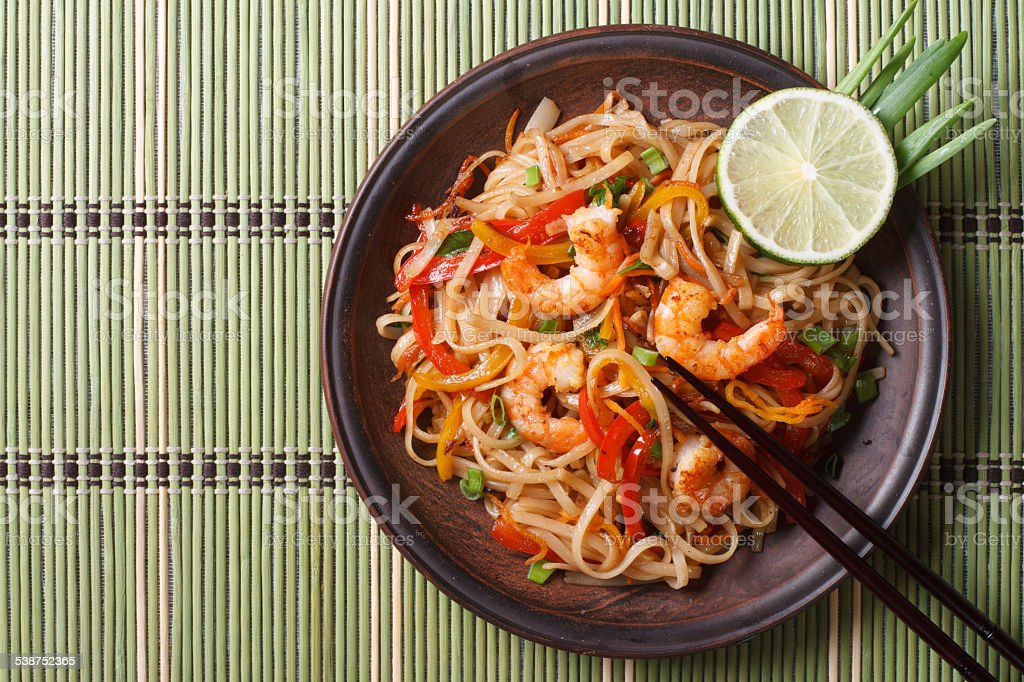 Delicious rice noodles with shrimp close-up top view stock photo