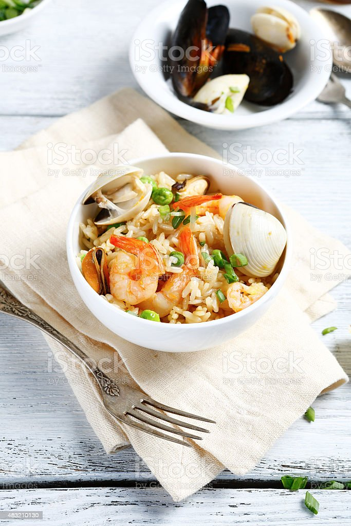 Delicious rice with shrimp and herbs stock photo