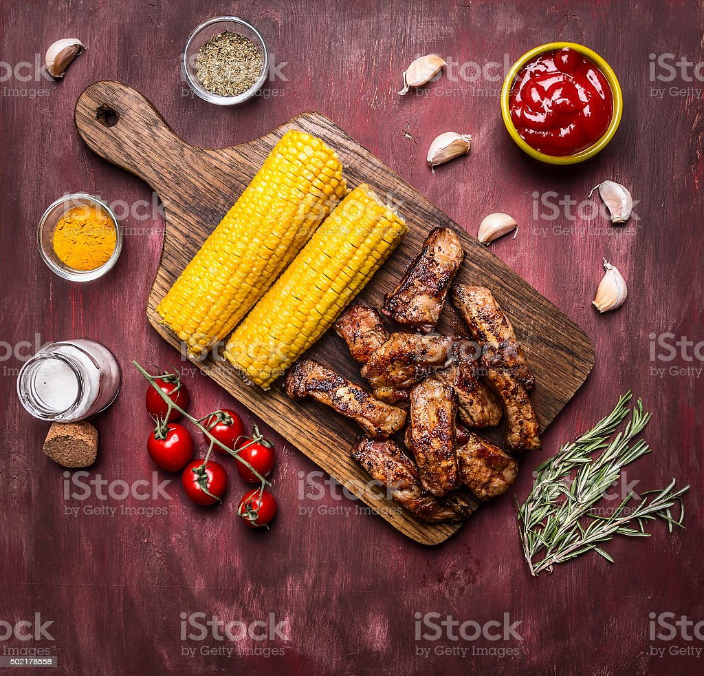 delicious roasted lamb ribs hot sauce, wooden rustic background top stock photo
