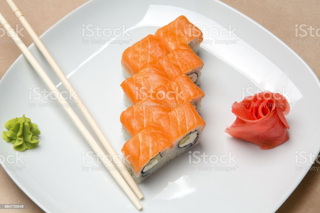 delicious rolls with salmon and chopsticks stock photo